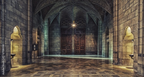 Fototapeta Interior of an old stone mansion with wooden half-open doors and light shining through the opening obraz