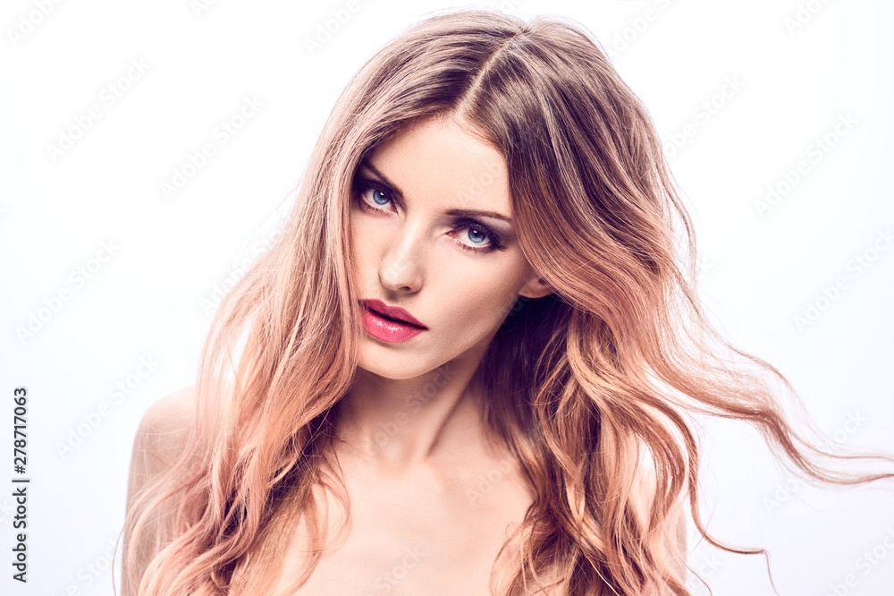 Fototapeta Beautiful fashion woman with perfect healthy skin, trendy wavy hairstyle, fashionable makeup smiling. Gorgeous blonde girl with styling shiny wavy hair. Beauty portrait. Skincare make up concept
