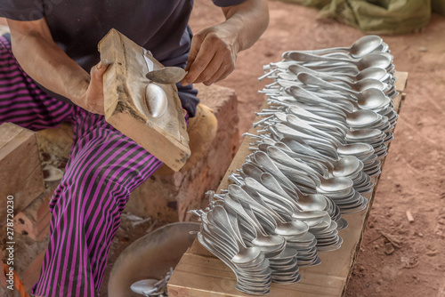 Photo  Locals in Laos make cutlery and jewellery using scrap aluminium salvaged from unexploded ordnance dropped during the U