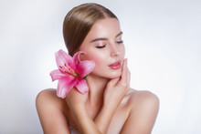 Beauty Face Of Young Woman With Flower. Beauty Treatment Concept. Cosmetic Concept