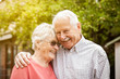 canvas print picture - old beautiful couple laughing and hug each other