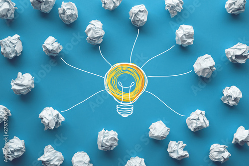 Obraz Creativity inspiration,ideas concepts with power of lightbulb and paper crumpled ball on color background - fototapety do salonu