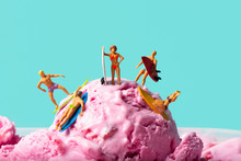 Miniature People Surfing On An Ice Cream Ball