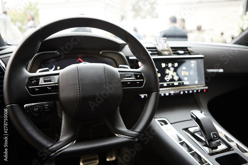 Modern luxury car Interior - steering wheel, shift lever and