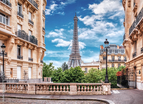 Small Paris street with view on the famous Eiffel Tower in Paris, France Wallpaper Mural