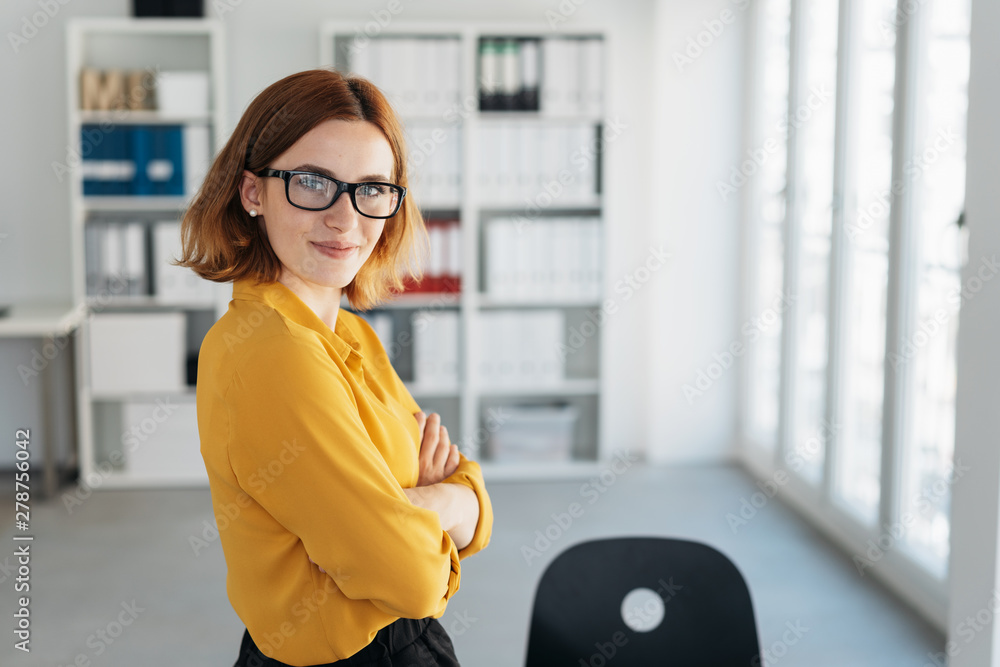 Fototapeta Smiling friendly self-assured young businesswoman