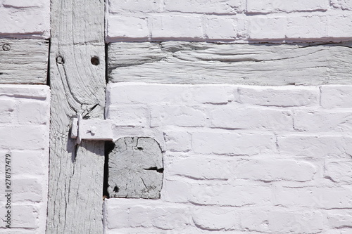 Fotografie, Obraz  Weisse Fachwerkbalken an weisser Hauswand,