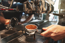 Barista Holding Coffee Holder With Ground Coffee Near Professional Coffee Machine Close Up