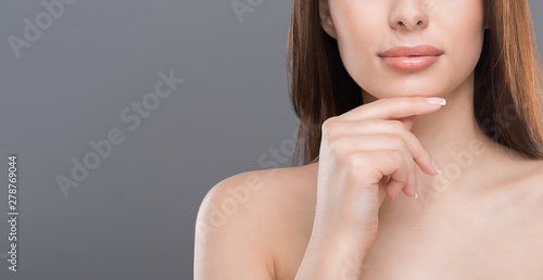 Poster Spa Young beautiful woman with perfect skin touching her chin