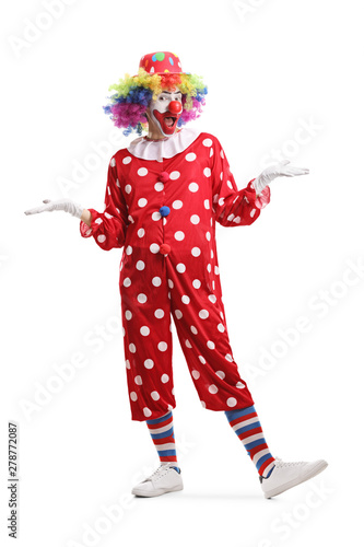 Cheerful clown standing and posing Fototapet
