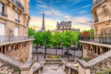 Fototapeta Fototapety z wieżą Eiffla - Small Paris street with view on the famous Eiffel Tower in Paris, France.