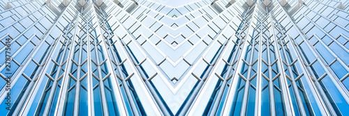 Fototapeta underside panoramic and perspective view to steel blue glass high rise building skyscrapers, business concept of successful industrial architecture