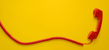 Red Vintage Telephone Handset Isolated On Yellow Background With Copy Space