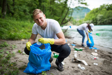 Cleaning River Beach From Garbage