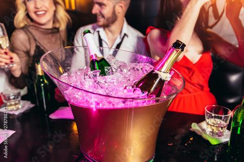Happy young people having fun at nightclub. - 278788252