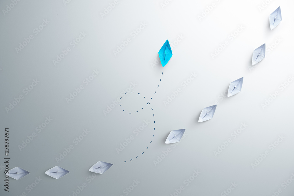 Fototapety, obrazy: Group of white paper ship in one direction and one blue paper ship pointing in different way on white background. Business for innovative solution concept, copy space