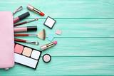 Fototapeta Kawa jest smaczna - Makeup cosmetics on mint wooden table
