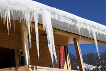 Wooden House With Snow Cornice...