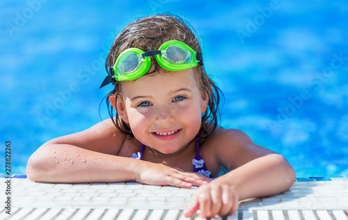 a girl swimming in a small pool Canvas Print