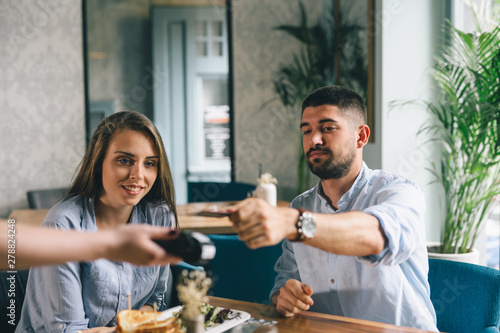 Fototapety, obrazy: man making payment in restaurant
