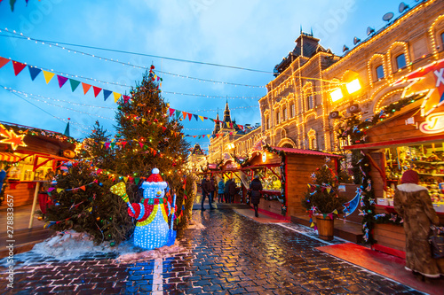 Celebration of the New Year and Christmas on the Red Square in the center of Moscow. Holiday fair and amusement park near the Kremlin