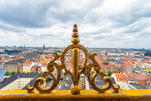 Golden Ornament Of The Tower Of Church Of Our Saviour With View Of City Center, Copenhagen, Denmark