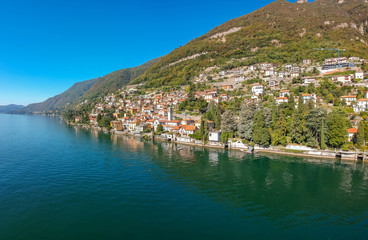 Aerial view landscape on beatiful Lake Como in Carate Urio, Lombardy, Italy. Scenic small town with traditional houses and clear blue water. Summer tourist vacation on rich resort with nice harbour