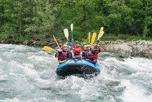 Group Of People Rafting In Rubber Dinghy On A River