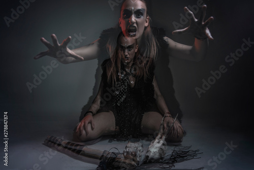 Fotografiet Possessed woman fighting her demons or dual nature