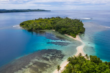 A Coral Reef Surrounds Idyllic...