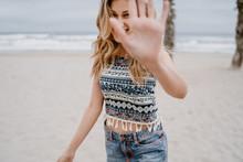 Portrait Of Smiling Young Woman Enjoying Beach