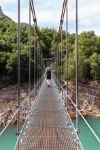 Man Doing Trekking While Crossing A Bridge