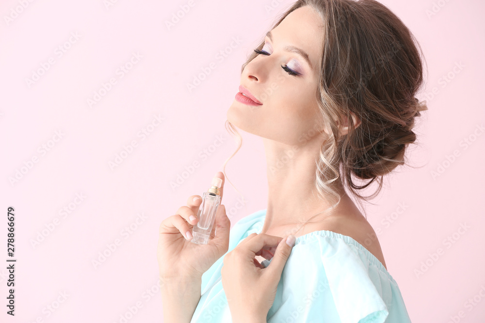 Fototapety, obrazy: Beautiful young woman with bottle of perfume on color background