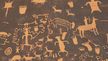 Shot Of An American Indian Art Petroglyph Of A Hunting Scene On Newspape