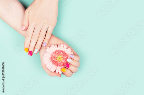 Foto op Aluminium Manicure Woman hands with perfect manicure and flower.