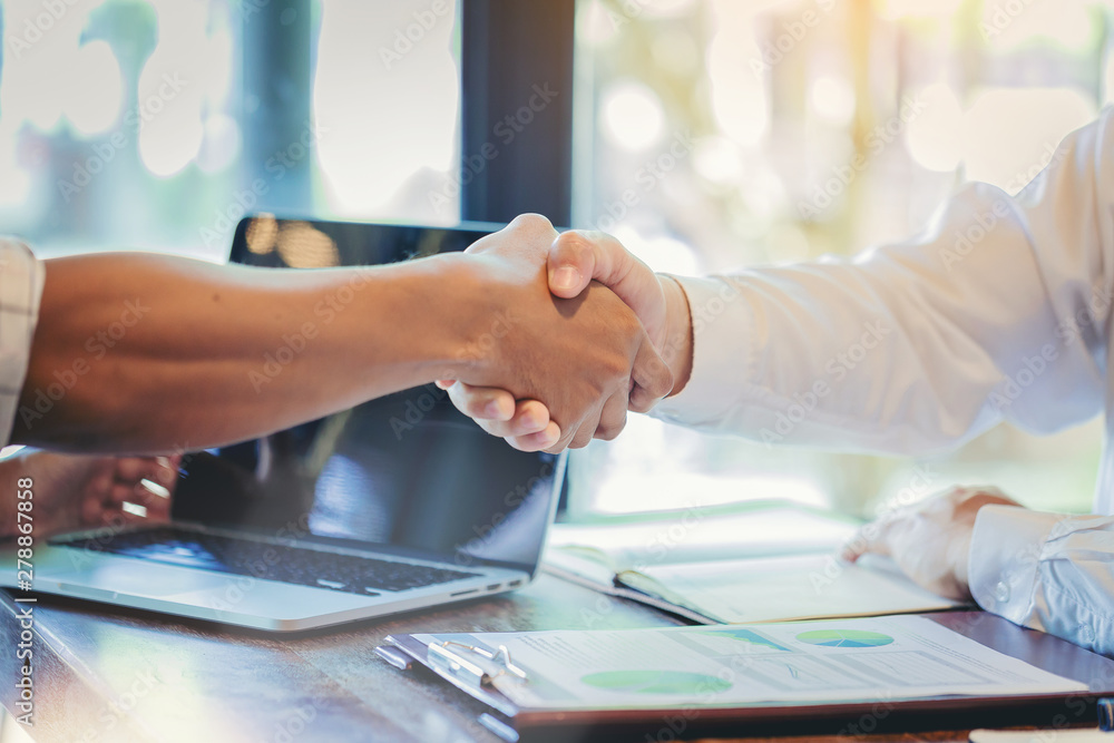 Fototapeta Businessman handshake at business meeting after negotiations with business partners.