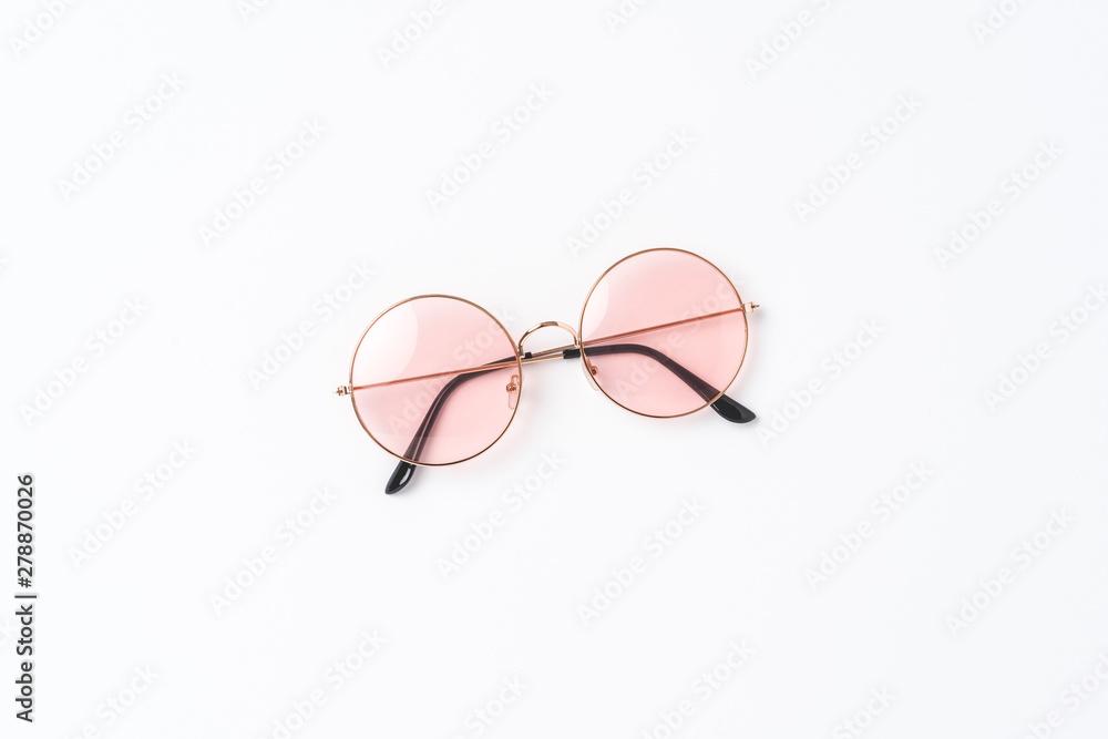 Fototapeta Round sunglasses on white background. Flat lay