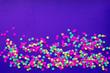 canvas print picture - Multicolored confetti in on a dark background