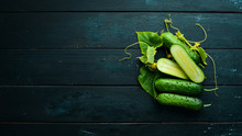 Sliced Fresh Green Cucumbers. On A Black Background. Top View. Free Space For Your Text.