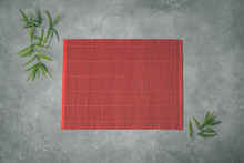 Bamboo Mat And Chopsticks On Gray Stone Background For Your Own Design Of Asian Food Concept