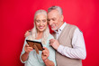 canvas print picture - Close up photo beautiful she her he him his aged white hair guy lady partners couple hold old first married picture image full feelings wear sweater shirt waistcoat isolated red burgundy background