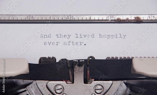 Valokuva The ending phrase And they lived happily ever after, printed on a paper page inside an old vintage typewriter