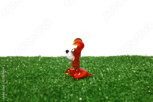 Poster Tuin Toy decorative glass on a white background. Animals, dogs, frogs.