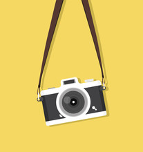 Hanging Vintage Camera With Strap On Yellow Background