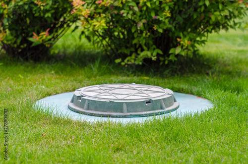 Fényképezés  cesspool on the backyard