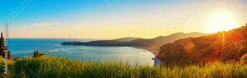 Obraz Panoramic view from above to the Adriatic sea coastline with Jaz beach at sunset time, Montenegro - fototapety do salonu