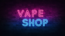 Vape Shop Neon Sign. Purple And Blue Glow. Neon Text. Brick Wall Lit By Neon Lamps. Night Lighting On The Wall. 3d Illustration. Trendy Design. Light Banner, Bright Advertisement