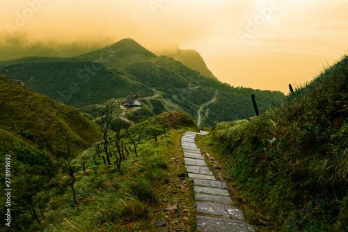 Fototapeta  Storybook-like pathway through a misty mountain landscape in Taiwan's Yilan Coun