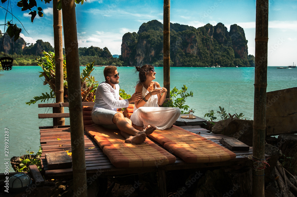 Fototapety, obrazy: Couple on their honeymoon. Couple travels the world. Happy couple on vacation. Man and woman traveling to Thailand. Holidays on beautiful Islands. Tourists on vacation. Trip to the islands