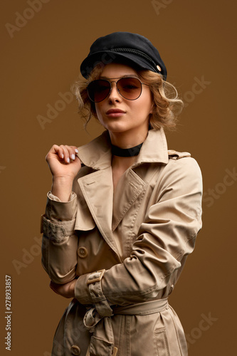 Young woman in trendy coat